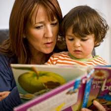 Woman with child reading a book